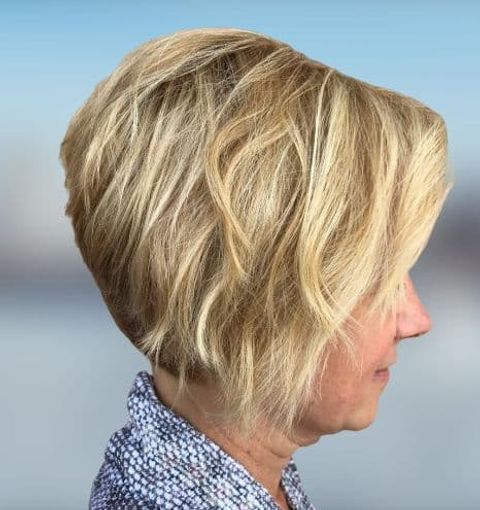 Layered asymmetrical short bob haircut for women over 60