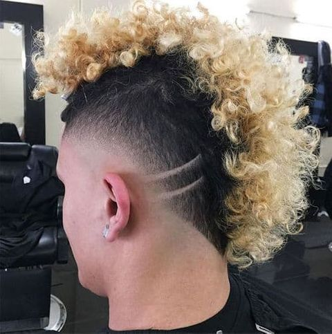 Blonde balayage curly mohawk haircut for men in 2021-2022