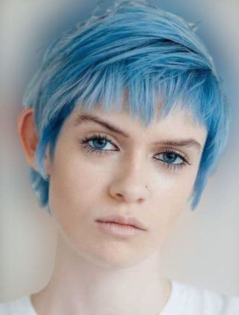 Side swept long pixie with blue hair color