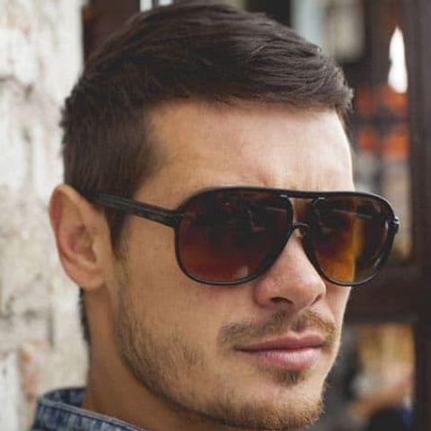 Tapered crew cut with glasses