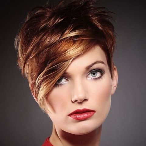 Layered short haircut with long bangs