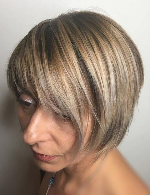 Asymmetrical short hair over 50