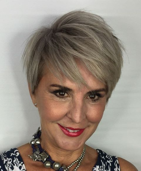 Layered blonde short haircut over 50