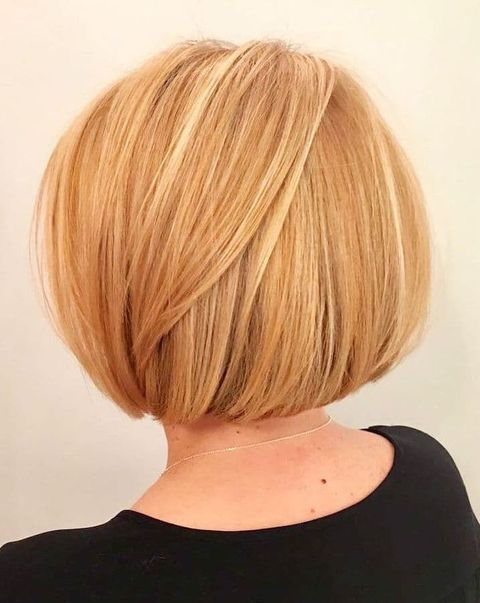 Short bob cut honey blonde color