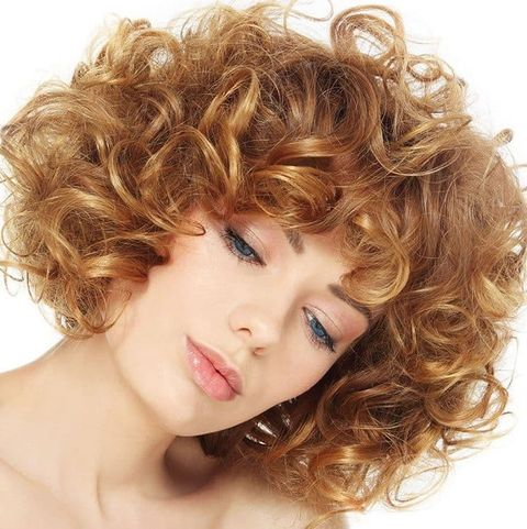 Honey blonde chin length curly haircut 2021-2022