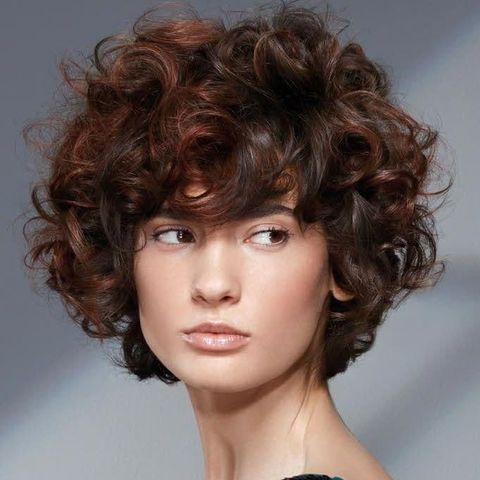 Messy curly haircut for oval face 2021-2022
