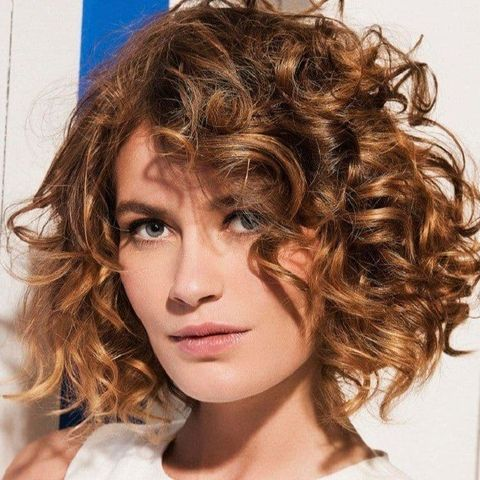 Side swept curl bob haircut for oval face 2021-2022