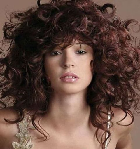 Voluminous mid-length curly hair for women 2021-2022