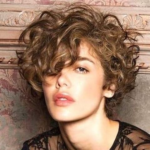 Curly bob haircut with bangs 2020 - 2021