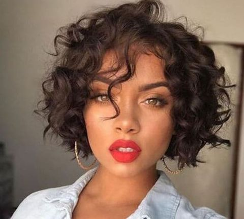 Curly short hairstyle with bangs for black women