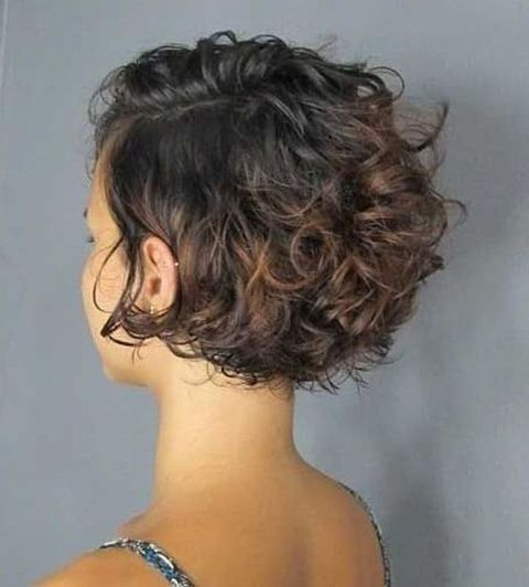 Side swept curly bob haircut 2020