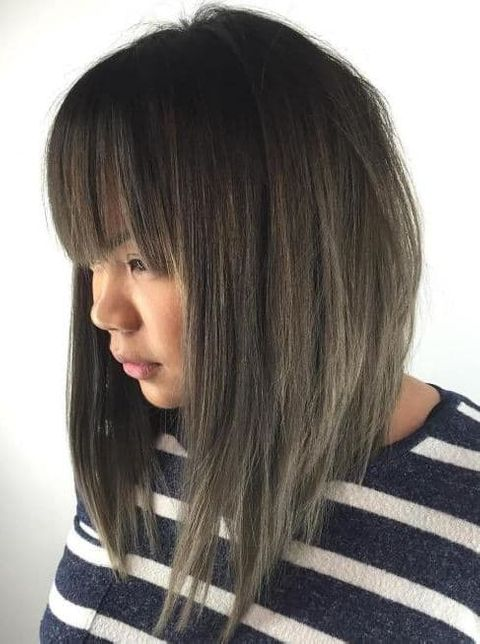 Angled lob cut with bangs