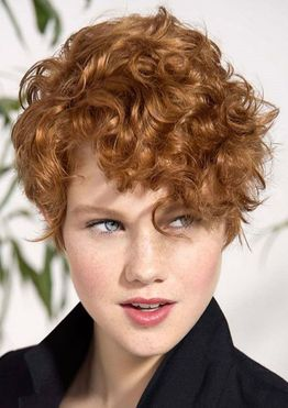 Brown hair color short curly haircut for woman with long face